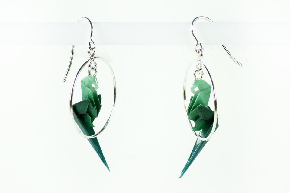 Fashion jewellery by the brand Joyas de Papel, parrot in silver hoop earrings