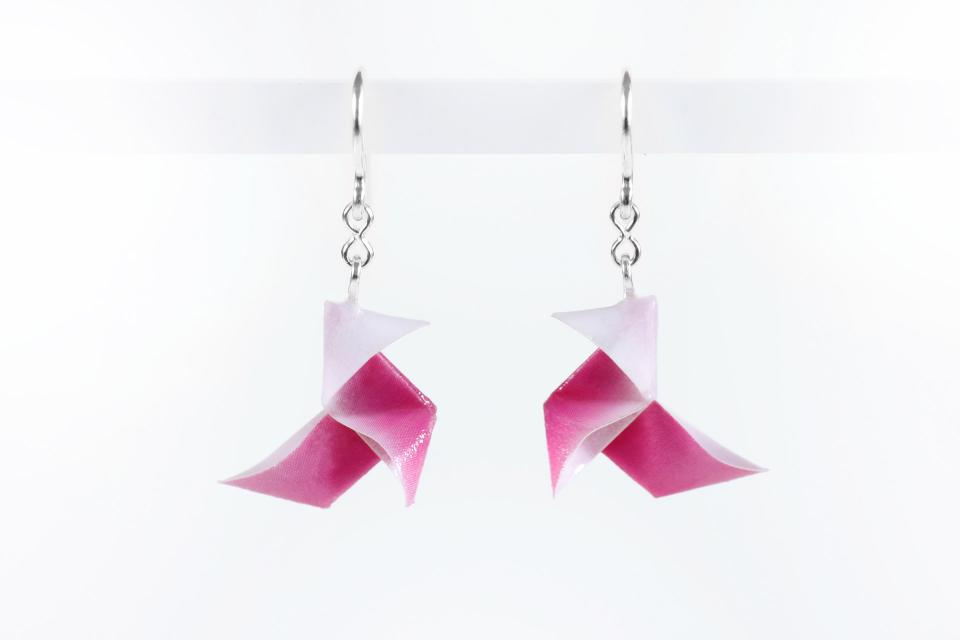 Economic earrings origami bird on paper