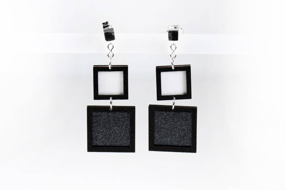 Earrings on silver and paper with square shape in black color, front view