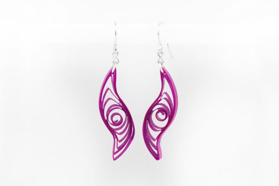 Creative colored earrings with paper ribbon and silver, front view