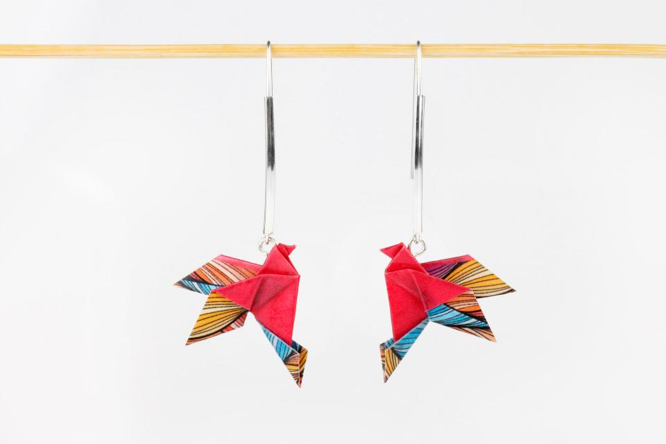 Modern earrings with paper bird and silver, front view