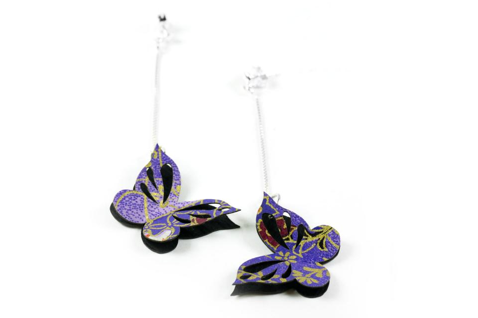 Hanging butterfly earrings on paper and sterling silver