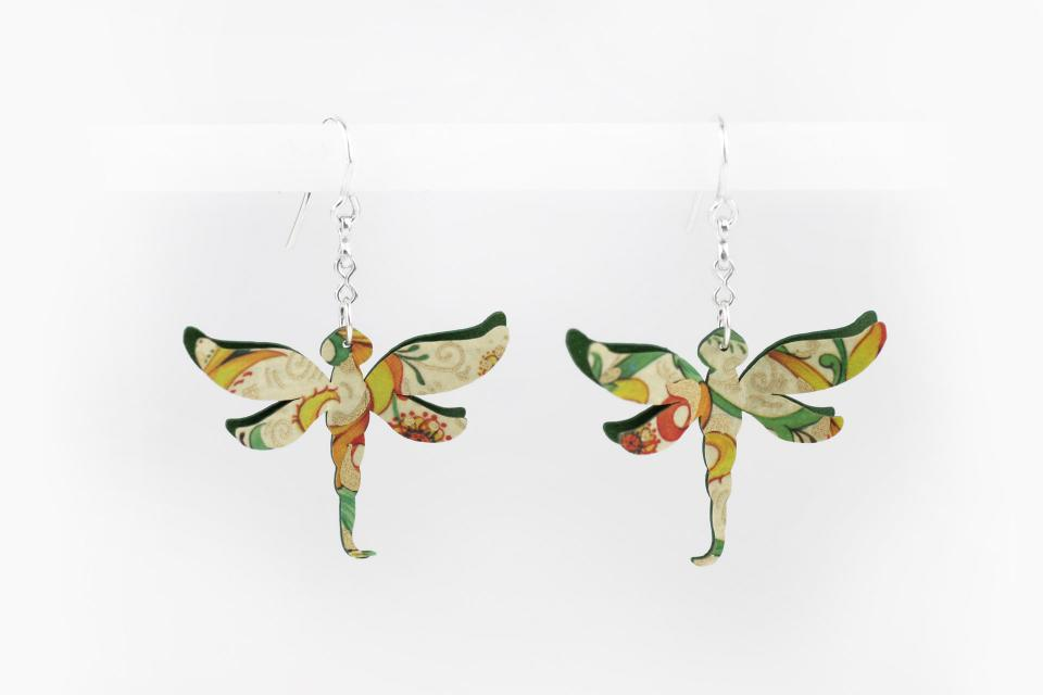 Fashion jewellery of fashion dragonfly earrings on paper, front view