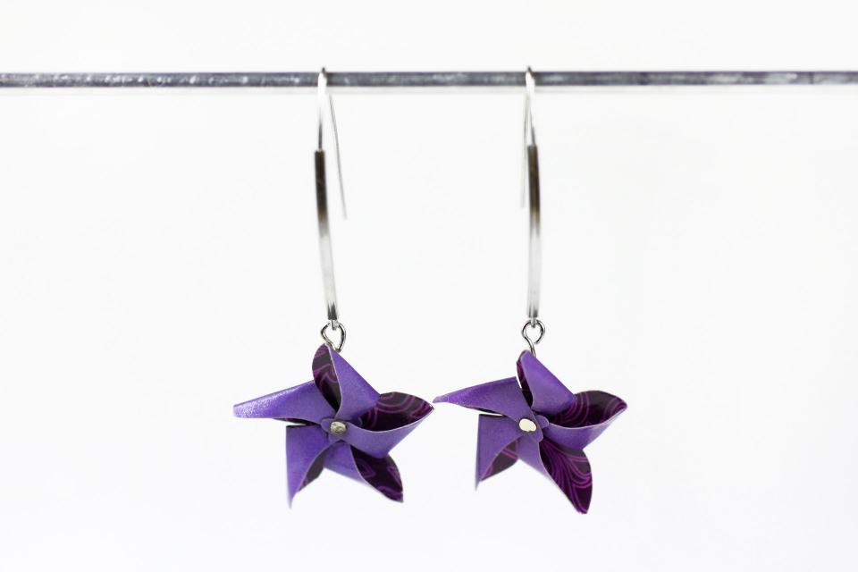 Fashion earrings with paper pinwheel, front view