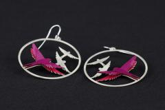 Detail view of two earrings with 925 silver hooks, filigree and birds of mauve paper layers, inlaid at the base with volume effect.