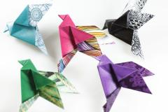 Paper bird brooches in fashion accessories