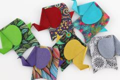 Group of origami elephants in varied colors