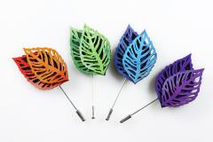 Coloured needle pins in the shape of coloured leaves