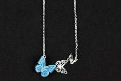 Silver necklace with three butterflies carved in different sizes, one of them with die-cut paper wings in blue shades and with relief effect.