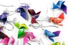 Handmade origami bird earrings on paper