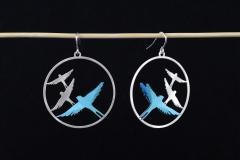 Sterling silver hook clasp earrings with birds in flight position, with paper bird settings made with blue layers.