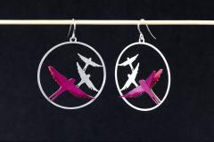 Front view of two earrings with a silver hook clasp and filigree of birds flying over them in layers of lilac paper.