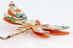 Juvenile brooch made with paper in the shape of a beautiful dragonfly