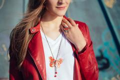 Model with butterfly ring, necklace and earrings set